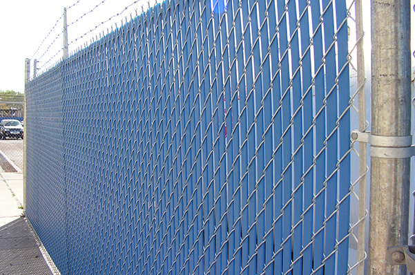 Outdoor chain-link fence with barbed wire